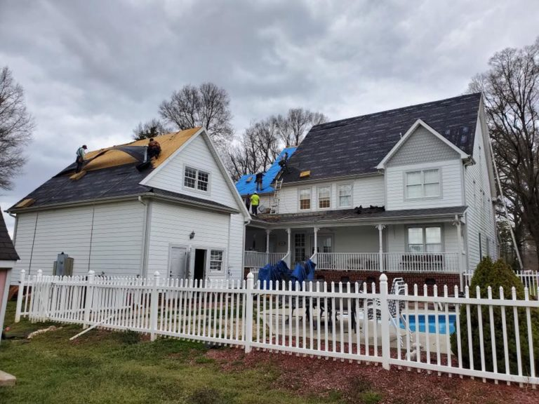 Lanier Rooging team replacing a roof after storm damage
