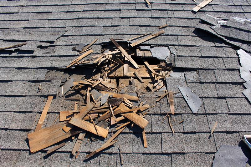A heavily damaged roof in need of repairs in Greenville.