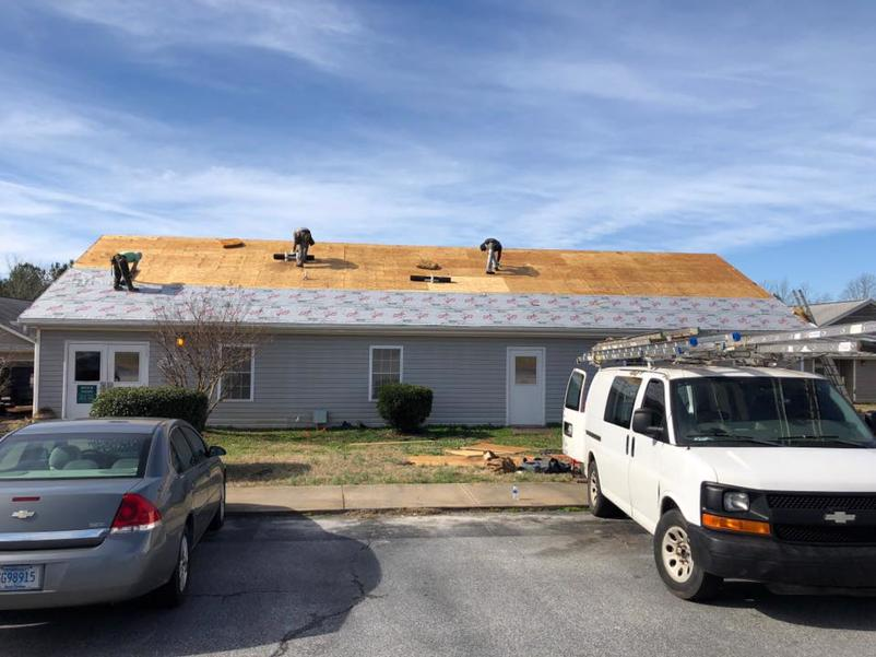 Our roof specialists working on a new roof construction project.