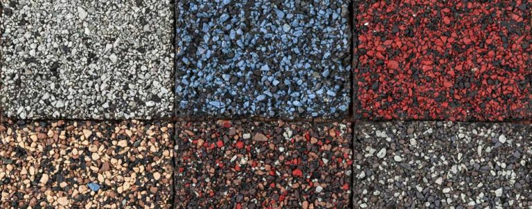 Different colors of asphalt shingles for a roof replacement.