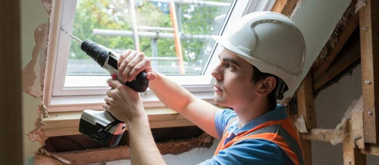 A window installer drilling in a new addict window.