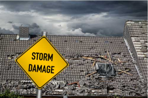 Roof with storm damage, insurance claim concept
